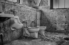 Toilets. Taken at an old abandoned mental hospital Royalty Free Stock Images