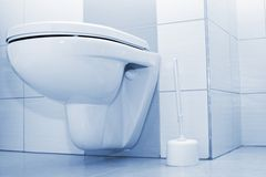 Toilette. Clean toilette in in a blue bathroom Royalty Free Stock Image