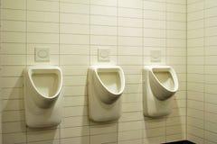 Toilette degli uomini Immagine Stock