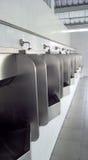 Toilette dell'uomo nella stazione dei gass Fotografia Stock Libera da Diritti
