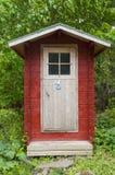 Toilette extérieure nordique Finlande Photos libres de droits