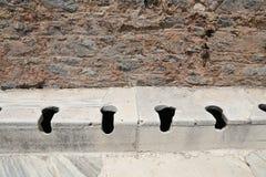 Toilette pubbliche della città antica di Ephesus Fotografia Stock