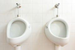 Toilette publique de mens photographie stock