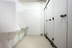 Toiletten- und Toilettentüren Stockfotos