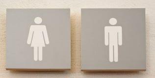Toilettenmann und weibliches Zeichen Stockbild