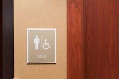 Toilettenmannzeichen und behindert Stockfotos