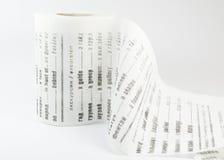 Toilettenpapier als lustiges russisch-englisches Wörterbuch auf weißem Hintergrund Lizenzfreie Stockbilder