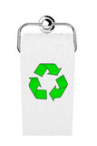 Toilettenpapier auf Chromhalter mit Grün bereiten Zeichen auf Stockfotografie