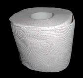 Toilettenpapier lokalisiert auf Schwarzem Stockfotografie
