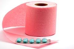 Toilettenpapier und Pillen Lizenzfreie Stockbilder