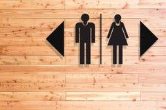 Toilettenzeichen auf konkreter Beschaffenheit Stockbild