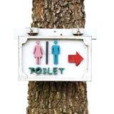 Toilettenzeichen mit einem Baum Lizenzfreies Stockbild
