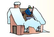 Toit de nettoyage de neige Images stock