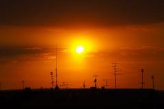 Toits des maisons au coucher du soleil Photo libre de droits