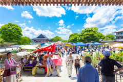 Toji Monthly Market People Stalls Shopping H. KYOTO, JAPAN - JUNE 21, 2015: People shopping at outdoor stalls of the once a month Toji market on the grounds of Stock Image