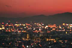 The toji temple and its pagoda in the sunset on the city of Kyoto illuminated with thousand fires. stock image