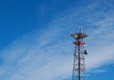 Tok Alaska Cell Tower. Tok, Alaska red and white metal Cell Tower with blue sky background royalty free stock image