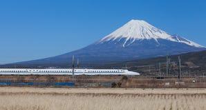 Tokaido Shinkansen with view of mountain fuji royalty free stock photography