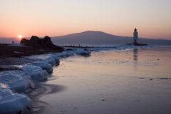 Tokarev lighthouse in the morning on the background of Russian island, Vladivostok Stock Image