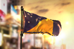 Tokelau Flag Against City Blurred Background At Sunrise Backligh Stock Photo