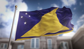 Tokelau Flag 3D Rendering on Blue Sky Building Background Stock Photography