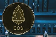 Token cryptocurrency Tron EOS against the numbers of the arithmometer. Token cryptocurrency EOS and the numbers of the arithmometer. The concept of EOS vector illustration