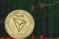 Token trx tron cryptocurrency on the background of binary crypto matrix text and price chart. Coin tron trx cryptocurrency on the background of binary crypto royalty free stock photography