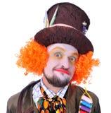 Tokiga olika ansikts- sinnesrörelser för hattmakare` s Närbildstående av smi Arkivfoto