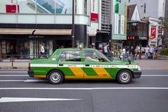 TOKIO JAPONIA - SEPTEMBER12,2015: taxi samochód w Tokyo ulicie, almos Zdjęcie Stock