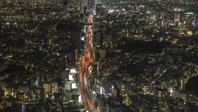 Tokio miasta widok Shibuya wzdłuż autostrady przy nocą, timelapse zdjęcie wideo