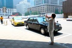 Tokio: Taxi przy Tokio jr stacją Obrazy Stock