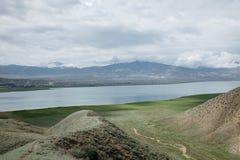 Toktogul highland mountain lake in Kyrgyzstan Stock Photo