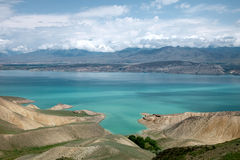 Toktogul  highland mountain lake in Kyrgyzstan Royalty Free Stock Images