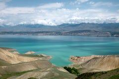 Toktogul  highland mountain lake in Kyrgyzstan Royalty Free Stock Images