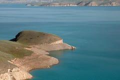 Toktogul  highland mountain lake in Kyrgyzstan Royalty Free Stock Photo