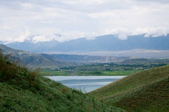 Toktogul  highland mountain lake in Kyrgyzstan Royalty Free Stock Photos