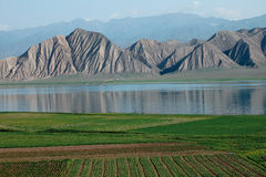 Toktogul  highland mountain lake in Kyrgyzstan Stock Image