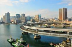 Tokyo. Japan - 2 January, 2012:  skyline seen from the Rainbow Bridge in Daiba district Stock Photography