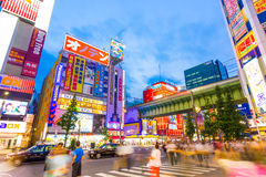 Tokyo Akihabara Main Street Train Bridge Hectic. Tokyo, Japan - July 29, 2015: Hectic hustle and bustle of main street in Akihabara among bright neon billboards Royalty Free Stock Photography