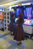 Tokyo arcades. Unidentified women at arcades in Tokyo, Japan. Tokyo is the worlds biggest center of public arcade culture Stock Photography