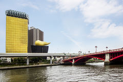 Tokyo architecture asahi beer tower and red asakusa bridge Royalty Free Stock Photos
