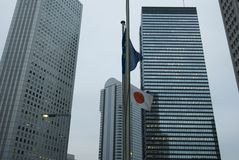 Tokyo background. Skyscrapers office buildings and Japanese state flag in center of Tokyo, Japan Stock Photos