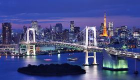 Tokyo Bay. Rainbow Bridge spanning Tokyo Bay with Tokyo Tower visible in the background Royalty Free Stock Images