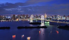 Tokyo Bay. Rainbow Bridge spanning Tokyo Bay with Tokyo Tower visible in the background Royalty Free Stock Image