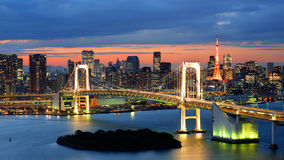 Tokyo Bay. Rainbow Bridge spanning Tokyo Bay with Tokyo Tower visible in the background Stock Photo