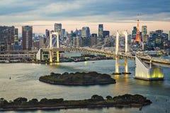 Tokyo Bay. Tokyo, Japan skyline with Rainbow Bridge and Tokyo Tower Royalty Free Stock Photography
