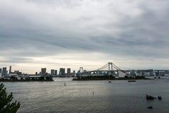 Tokyo bay and Rainbow Bridge in Odaiba Royalty Free Stock Photography