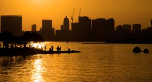 Tokyo Bay sunset. Beautiful sunset over Tokyo Bay with tall buildings and construction cranes Stock Images