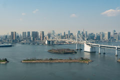 Tokyo Bay with a view of the Tokyo skyline and Rainbow Bridge in Stock Images