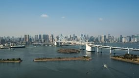 Tokyo Bay with a view of the Tokyo skyline and Rainbow Bridge in Stock Photo